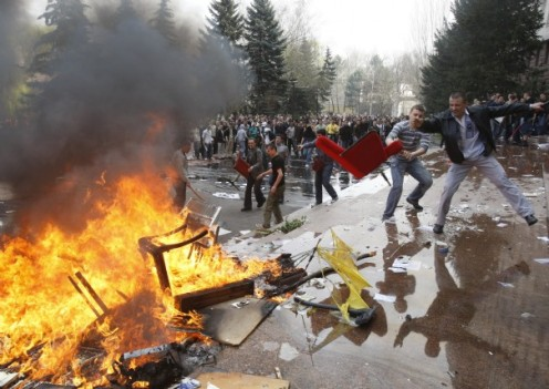 1-people-throw-furniture-into-a-fire-during-a-violent-protest-outside-parliament-in-chisinau_26