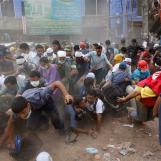 People run after they heard someone shouting that a building next to Rana Plaza is collapsing during a rescue operation in Savar