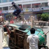 Garment workers vandalize an auto rickshaw demanding the arrest of the owner of the Rana Plaza building in Dhaka
