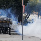 2471161_riot-police-chase-demonstrators-near-the-maracana-stadium-in-rio-de-janeiro