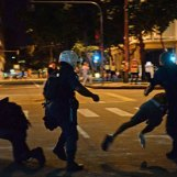 Riot police tackle a protester during clashes in Rio that marred a plan peaceful day of action