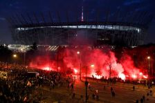 Far-right protesters throw flares in front of the National Stadium during the annual far-right rally, which coincides with Poland's National Independence Day in Warsaw