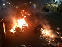 Dumpster fires burn along Broadway in Oakland the early morning hours of Nov. 9, 2016 after demonstrators took to the streets to protest the election of New York businessman Donald Trump as president of the United States.