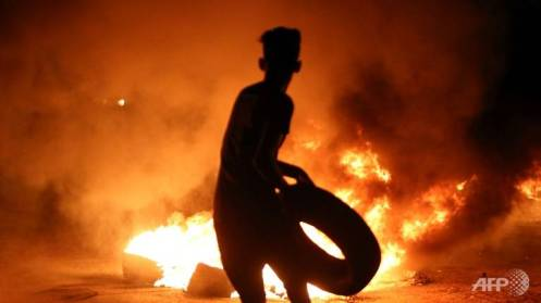 a-demonstrator-burns-tyres-during-protests-against-unemployment-and-high-cost-of-living-in-the-southern-iraqi-city-of-basra-during-the-night-of-july-12-2018-1531474271161-2